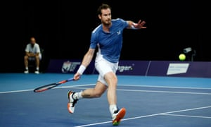 Andy Murray plays a forehand during his singles match against James Ward on day 3 of the Battle of the Brits at the National Tennis Centre on June 25