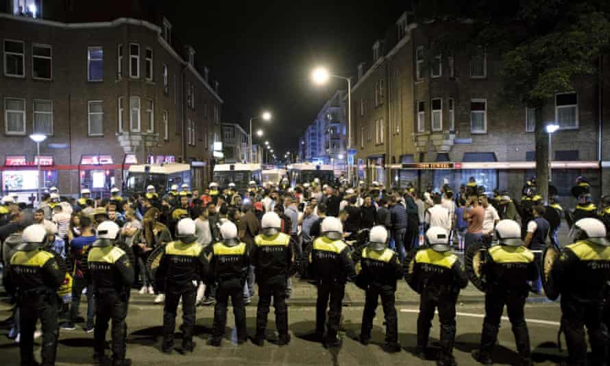 Dutch riot police clash with protesters in Schilderswijk, The Hague.