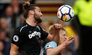 Andy Carroll's elbow connects with Burnley's Ben Mee, leading to a second yellow card.