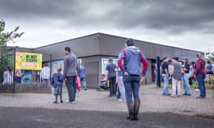 Parents and children outside school gates, in kettering