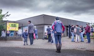 Parents and children arriving at school gates