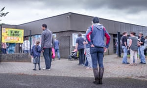 Parents and carers wait at the school gate