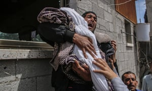 A Palestinian relative of fourteen-month baby girl Seba Abu-Arrar carries her body during her funera in the Al-Zaitun neighborhood in the east of Gaza City.