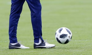 Iran's head coach Carlos Queiroz is pictured wearing Nike boots in a training session in Russia.