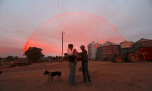 Farmer Tom Wollaston's wife Margo talks with her daughter Natasha and her granddaughter Abbey as a rainbow forms above them at sunset on their drought-effected property, located west of the town of Tamworth, in north-western New South Wales in Australia, June 2, 2018. Picture taken June 2, 2018.    REUTERS/David Gray      TPX IMAGES OF THE DAY      TPX IMAGES OF THE DAY