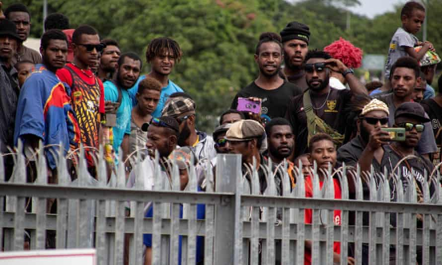 A crowd gathers in front of Jackson International Airport in Port Moresby to bid farewell to the coffin of Papua New Guinea's first prime minister, Michael Somare, on March 14.