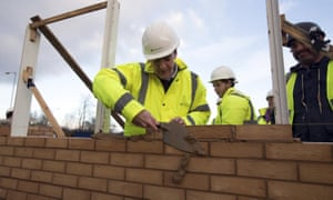 George Osborne lays a brick during a visit to a housing development