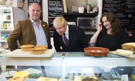 Boris Johnson looks at pies in Deli a GoGo in Whitchurch village with the leader of the Welsh Conservatives, Andrew RT Davies (left), and the AM candidate for Cardiff North, Jayne Cowan, in Cardiff last month.