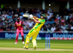 Nathan Coulter-Nile pulls the ball to the boundary for six.