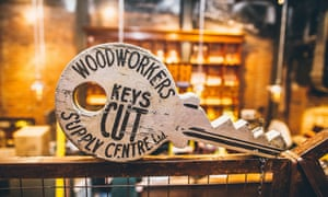 A giant wooden key on the bar at The Woodworkers, Belfast.