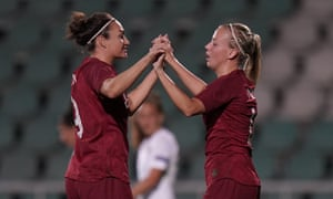 Beth Mead celebrates with Jodie Taylor.