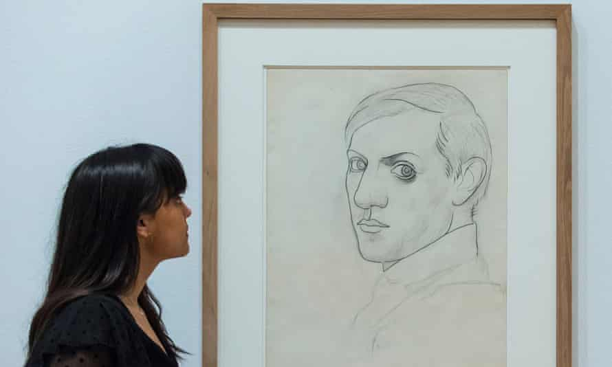 A woman views Self-portrait (Montrouge), 1918, by Pablo Picasso.