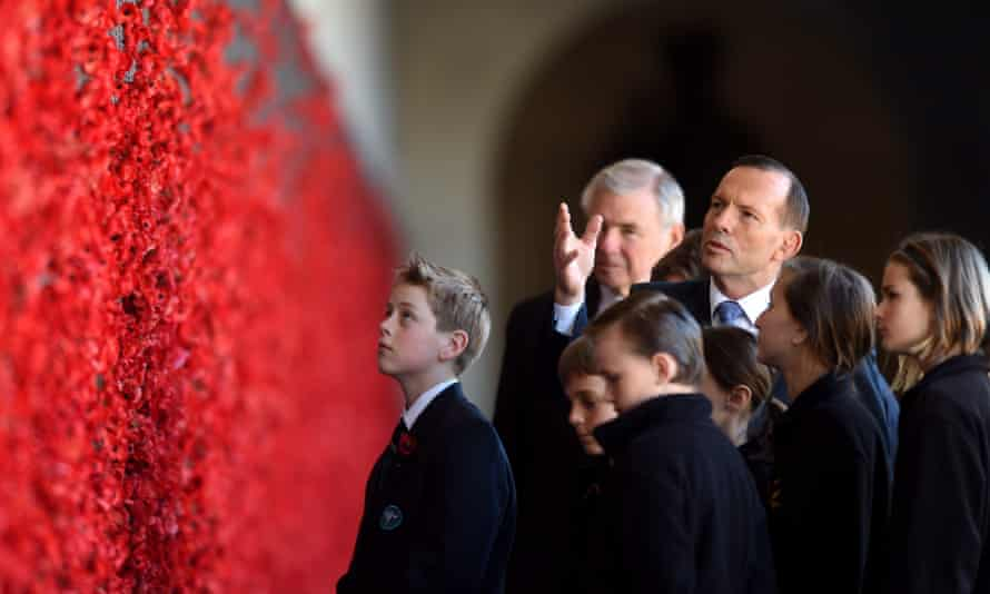 'The obvious place to start is to ensure that every Australian child gets a great education.' Tony Abbott, the prime minister, with schoolchildren at the Australian War Memorial.