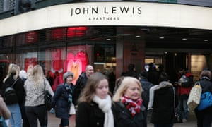 Shoppers walk past John Lewis on Oxford Street