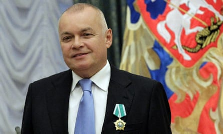 Russian journalist Dmitry Kiselyov posing for a photo in 2011.