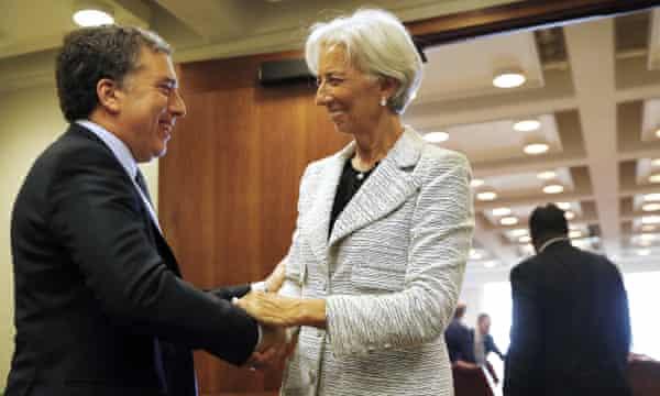Argentina's treasury minister, Nicolás Dujovne, greets Christine Lagarde, the managing director of the IMF, in Washington.