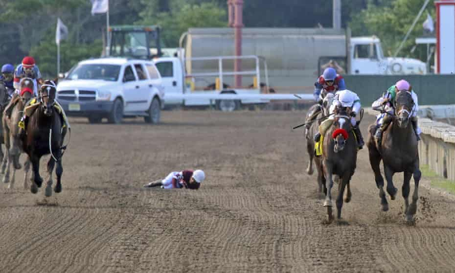 Hot Rod Charlie (right) and Mandaloun (far right) race to the finish line at Monmouth Park after jockey Paco Lopez fell from Midnight Bourbon.