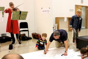 Harry Venning draws with musicians at the Guardian Education Centre Cartoon and art family day 17 November 2018