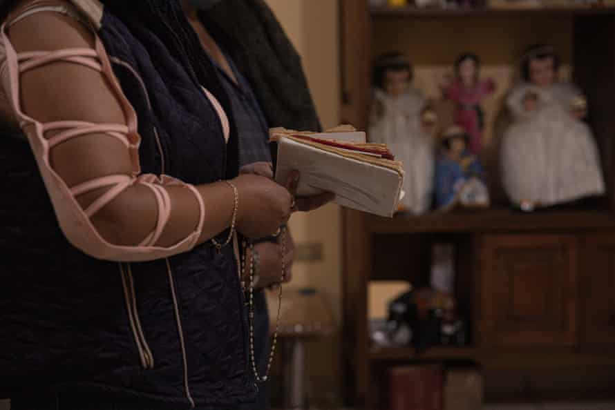 In certain areas of Mexico people hire a 'rezandera' a woman who says the rosary aloud for the family.