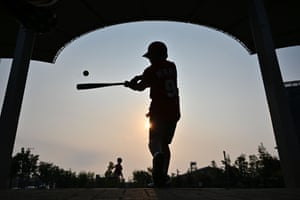 A boy in Tokyo plays baseball, one of the most popular sports in Japan