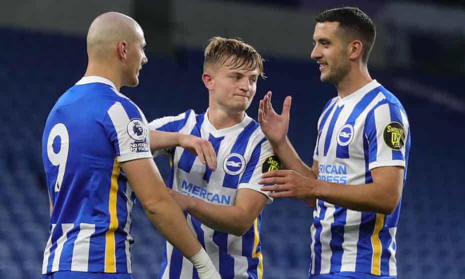 The 35-year-old Gary Dicker (right) with two 19-year-old members of Brighton's under-23s, Lorent Tolaj (left) and Sam Packham, during last month's game against Blackburn.