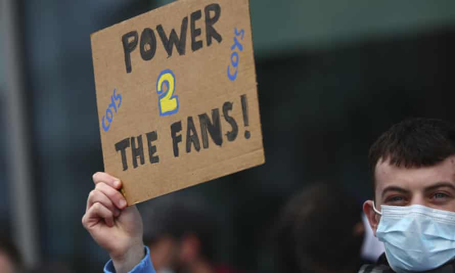 A Tottenham fan takes part in a protest against the creation of a European Super League, outside the Tottenham Hotspur Stadium in London, England