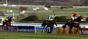 Long Run edges past Denman and Kauto Star (left) in the final stages to take the Gold Cup.