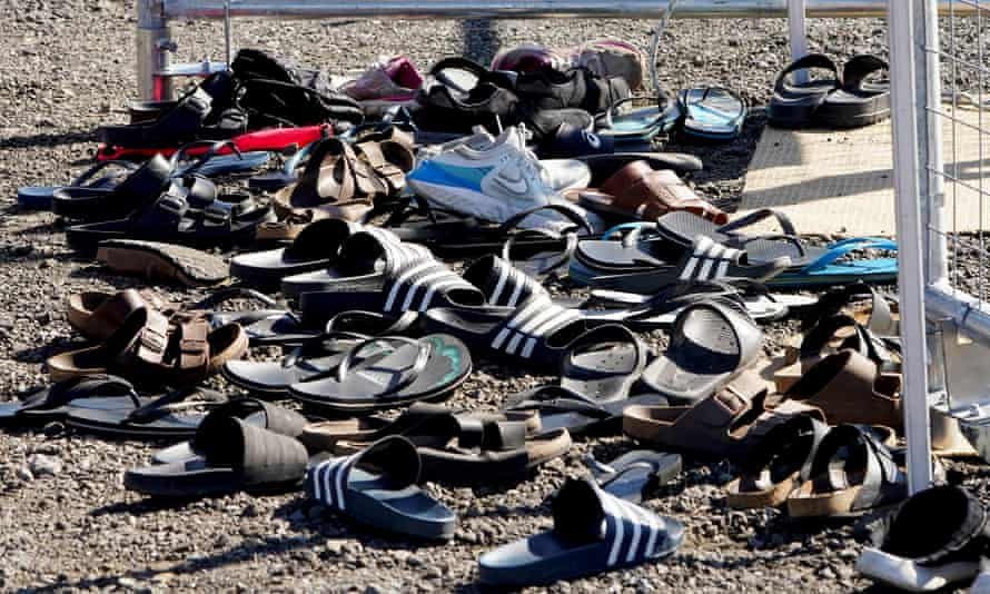Players' shoes are seen left outside the secure training area during a NRL Titans training session on the Gold Coast on Monday.