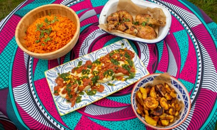 Jimi's lockdown dishes of jollof rice, roast chicken, steamed yam with corned beef stew, fried plantain.