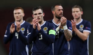 Andrew Robertson and teammates applaud the fans after the match.