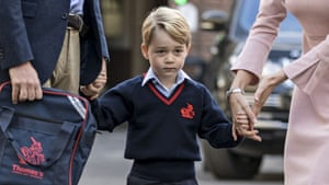 Prince George holds hands with his father and one of his teachers