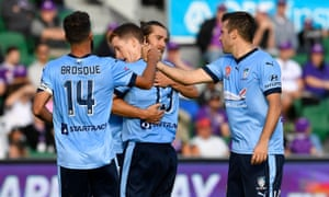 Sydney FC team-mates celebrate with Brandon O'Neill