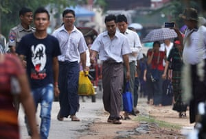 Reuters reporters Wa Lone and Kyaw Soe Oo walk to freedom in Yangon, Myanmar, after receiving a presidential pardon.
