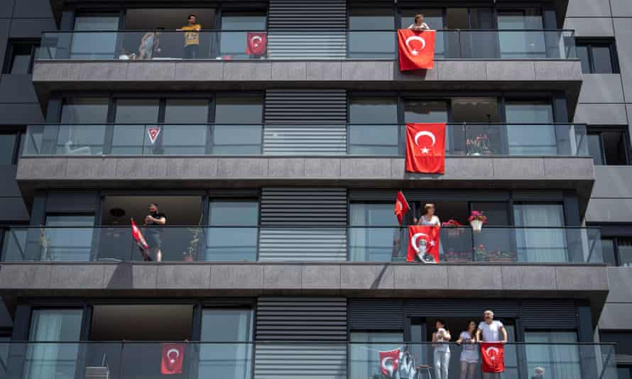 People display flags outside their apartments in Istanbul, Turkey, to mark a public holiday on 19 May