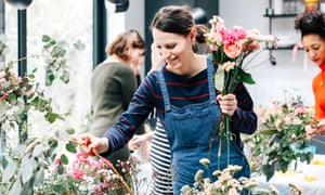 A woman in dungarees