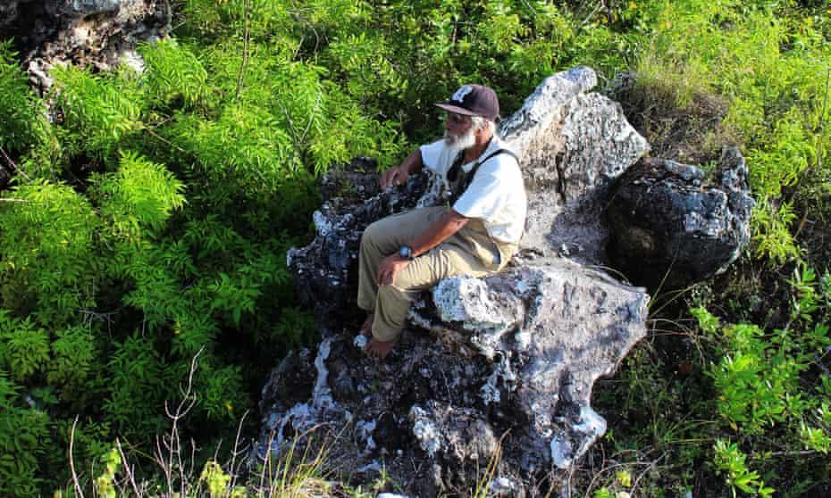 Roubena Ritata sits on a rock on Banaba