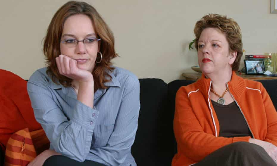 Demanding mother telling off young daughter and young adult fed up with still living in at parental home