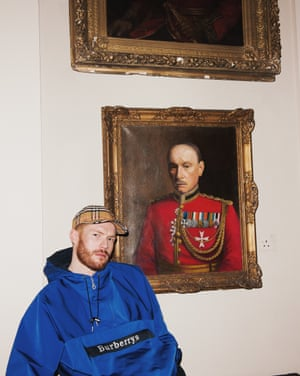 A model wearing Burberry clothes in front of an old portrait