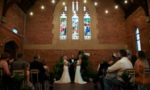 """Rebecca Hickson (left) and Sarah Turnbull are married in a ceremony in Newcastle on 9 January, the first official day same-sex marriage ceremonies were allowed in Australia. He warned that forcing people to accept others' views of marriage would lead to """"more conflict and acrimony in public debate""""."""