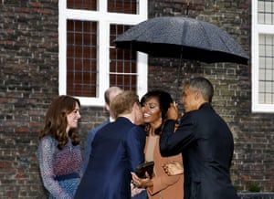 A cordial affair: Barack Obama shields the First Lady from the rain as she meets Prince Harry.