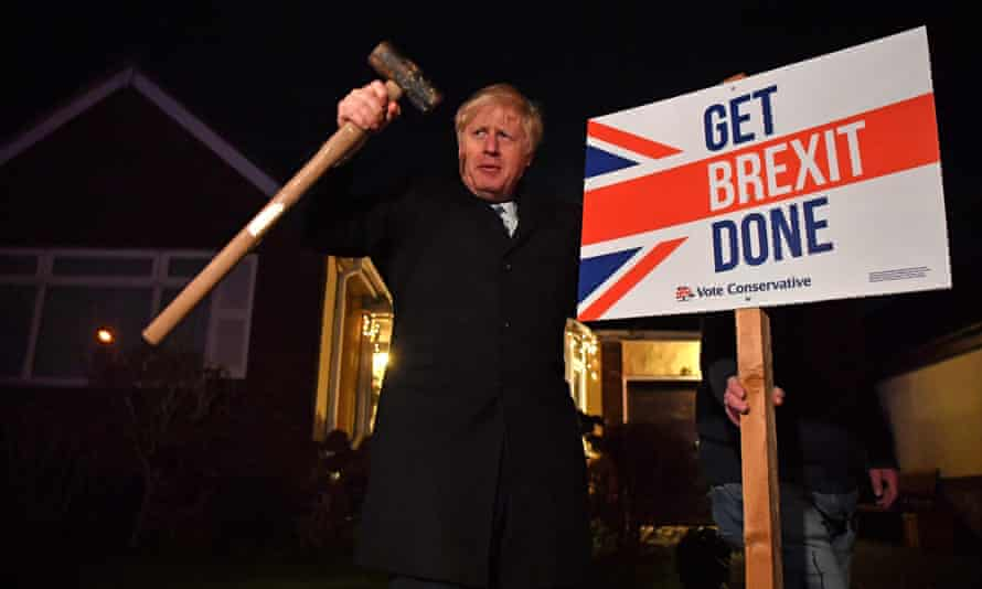 "Boris Johnson poses after hammering a ""Get Brexit Done"" sign into the garden of a supporter in Benfleet, Essex, December 2019"