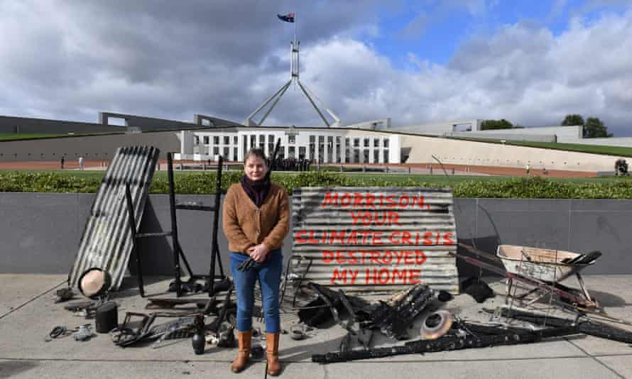 Melinda Plesman with the remains of her burnt-out house, outside Parliament House in Canberra
