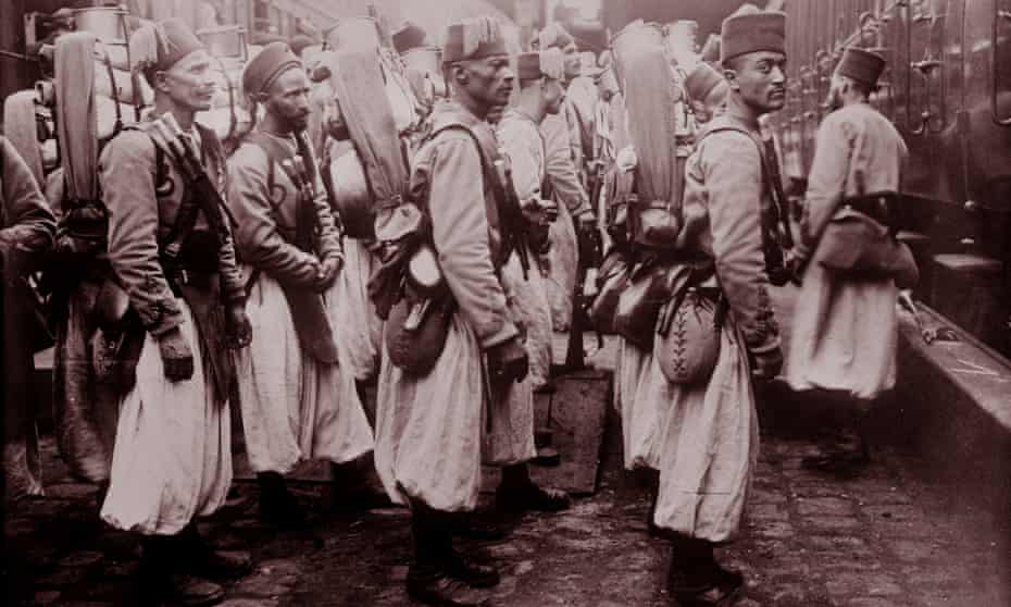 Algerian soldiers on the way to the western front arrive in Paris in 1914.