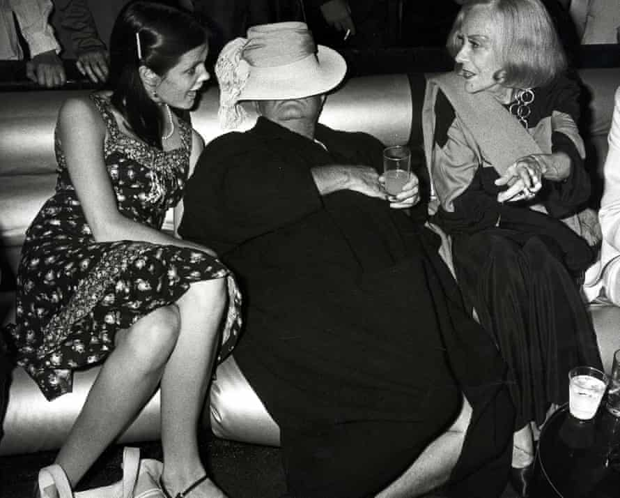 'Adoptive daughter' … Kate Harrington, left, with Capote and Gloria Swanson.