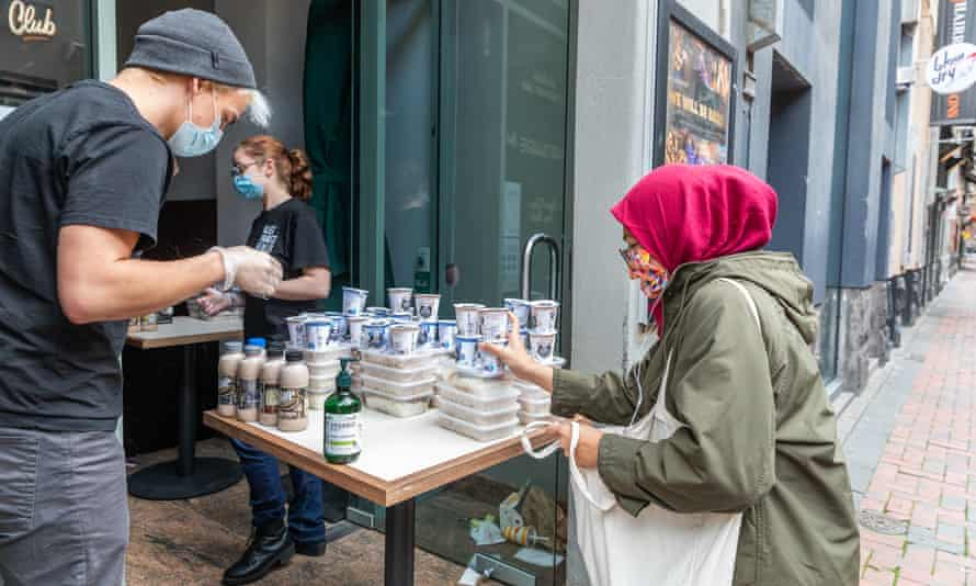 An international student collects food from Alex Dekker, founder of the Melbourne charity Alex Makes Meals, in July
