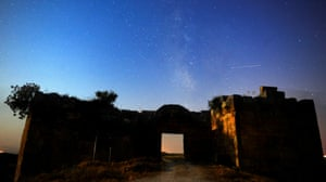 Meteors light up the sky above the ancient city of Blandus in Usak, Turkey