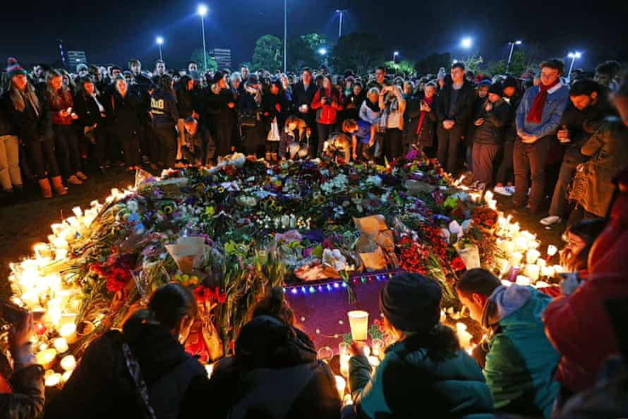 Mourners in Princes Park, Melbourne, pay their respects to Eurydice Dixon.