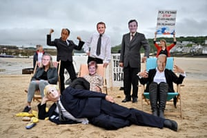 Extinction Rebellion activists stage a protest on the beach in St Ives