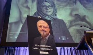 Video footage of Hatice Cengiz appears on screen during a memorial event for her fiancee Jamal Khashoggi in Washington in November.