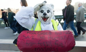 A demonstrator dressed as a polar bear protests at Westminster Bridge on 17 November